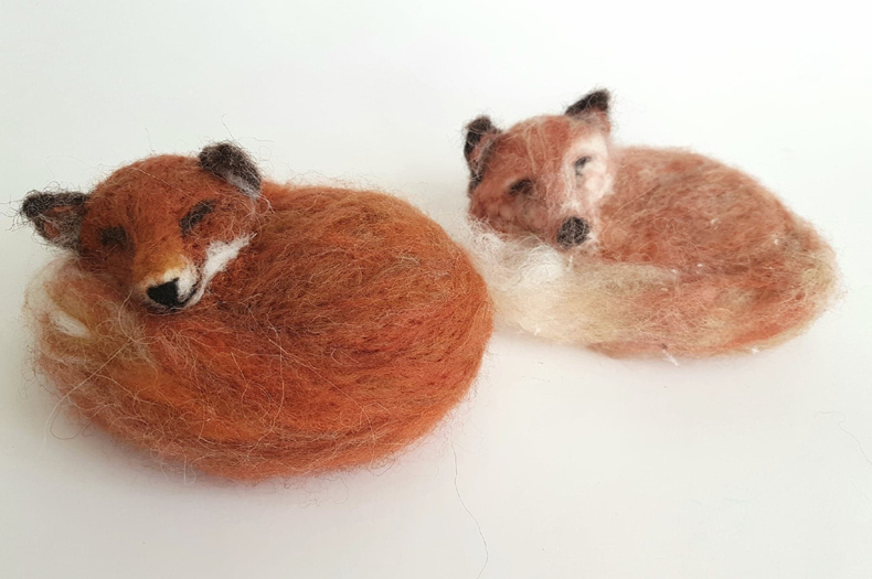 Felted stylized foxes